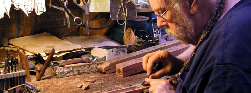 Long-time flute maker Ken Light in his shop in Montana